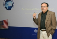 delivering his talk at torrent world symposium